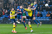 Sunderland forward Charlie Wyke (9)  heads the ball  at goal under pressure from Oxford United defender John Mousinho (15) and Oxford United defender Rob Dickie (4) during the EFL Sky Bet League 1 match between Oxford United and Sunderland at the Kassam Stadium, Oxford, England on 15 February 2020.