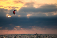 An outdoor athleteg as seen kitesurfing on a sunny and windy evening at the North Sea, near the bay of Lauwersoog, Groningen, the Netherlands.g
