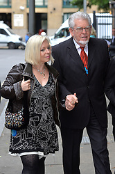 Rolf Harris and his daughter Bindi Nicholls arrive at Southwark Crown Court, London, UK.<br /> <br /> Tuesday 3rd June 2014.<br /> Picture by Ben Stevens / i-Images
