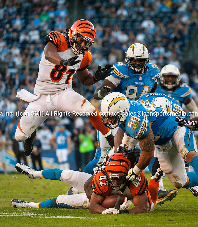 Cincinnati Bengals Running Back Ben Jarvus Green-Ellis (42) [10517] gets tackled during an NFL game against the Chargers at Qualcomm Stadium in San Diego.