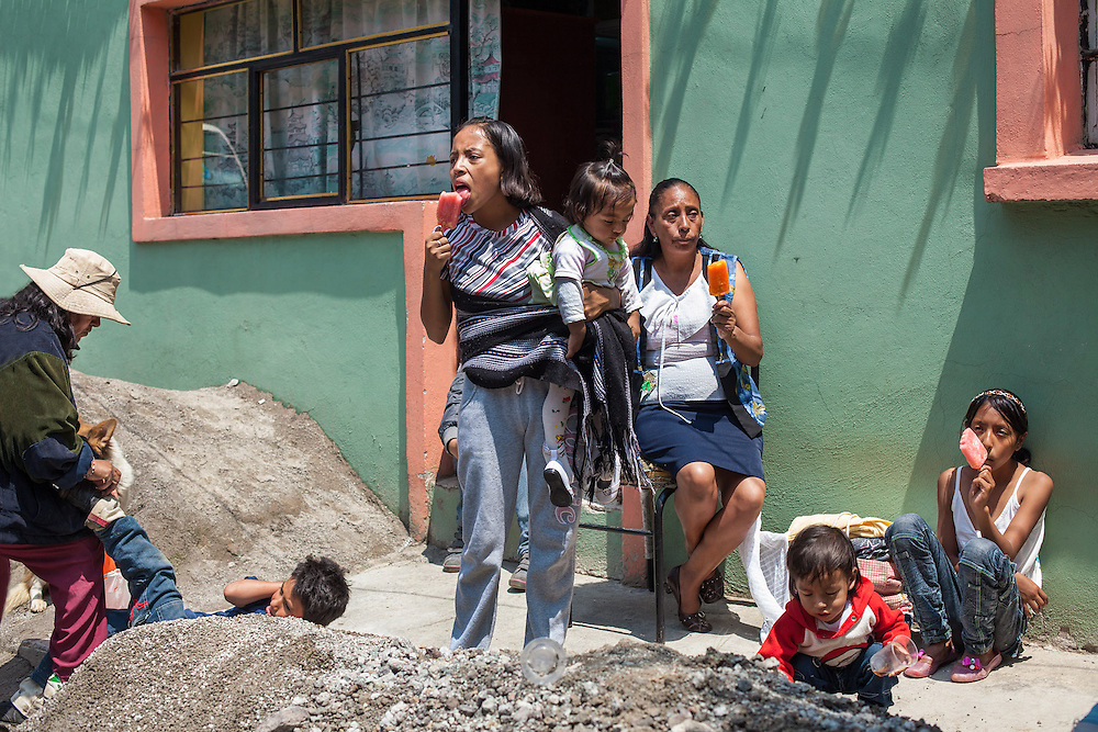09/ 2011 - Patron San Mateo Tezoquipan' s festival in the city of Miraflores, Chalco, Mexico. The people of the village moves as a group with the statue of the saint, knocking house to house. Home owners, come out giving all participants, big ice lollies made of fresh fruit. So in an afternoon you end up eating a large amount of ice lollies! But it never misses a bottle of tequila hidden under the saint's robes.