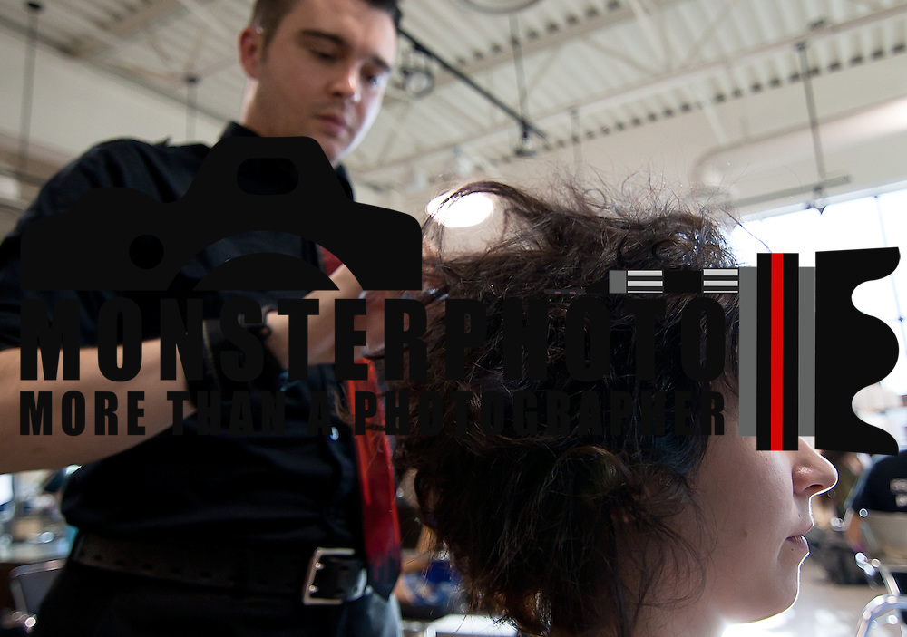 04/20/12 Newark Del. Stylist Randall Eastridge works on model Cynthia Doyle hair during a dress rehearsal Friday, April. 20, 2012 at The Paul Mitchell school of Delaware Friday, April. 20, 2012 in Newark Del...Special to The News Journal/SAQUAN STIMPSON