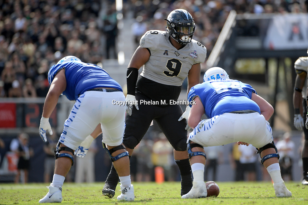 Central Florida defensive lineman Trysten Hill (9) sets up for a play during the first half of the American Athletic Conference championship NCAA college football game against Memphis Saturday, Dec. 2, 2017, in Orlando, Fla. (Photo by Phelan M. Ebenhack)