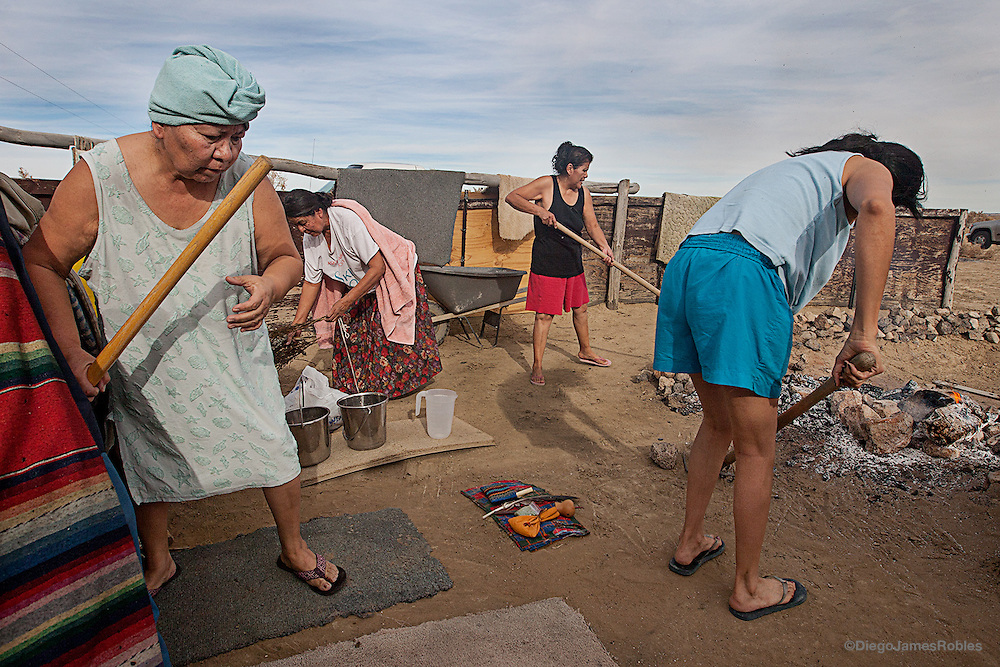 Women attending a sweat lodge ceremony prepare hot stones and medicinal plants in between prayer rounds in Coyote Canyon, Navajo Nation, on Sunday afternoon, Dec. 5, 2010. Some Navajo women participate in sweat lodge ceremonies asa type of physical and spiritual purification.
