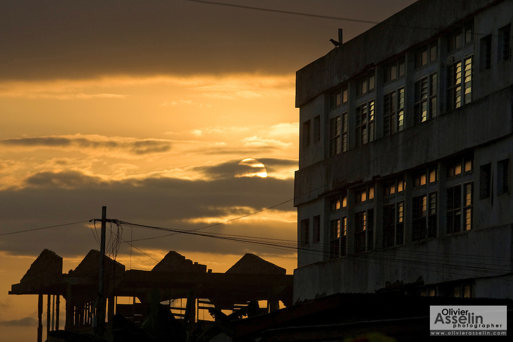 The sun is reflected in the windows of a building in Cape Coast, Ghana on Saturday September 6, 2008.