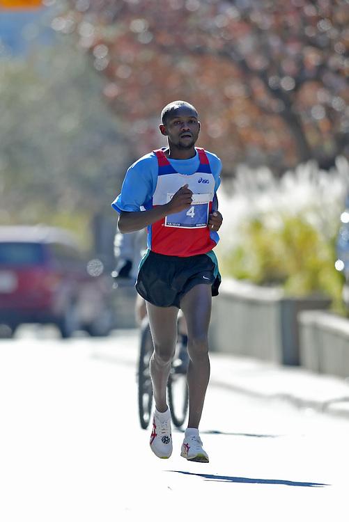 "(Toronto, Ontario -- 18 Oct 2009)   JOEL KIMARU runs to second place in the Goodlife Fitness Toronto Marathon. [Photo credit should read ""Sean Burges / Mundo Sport Images""]"