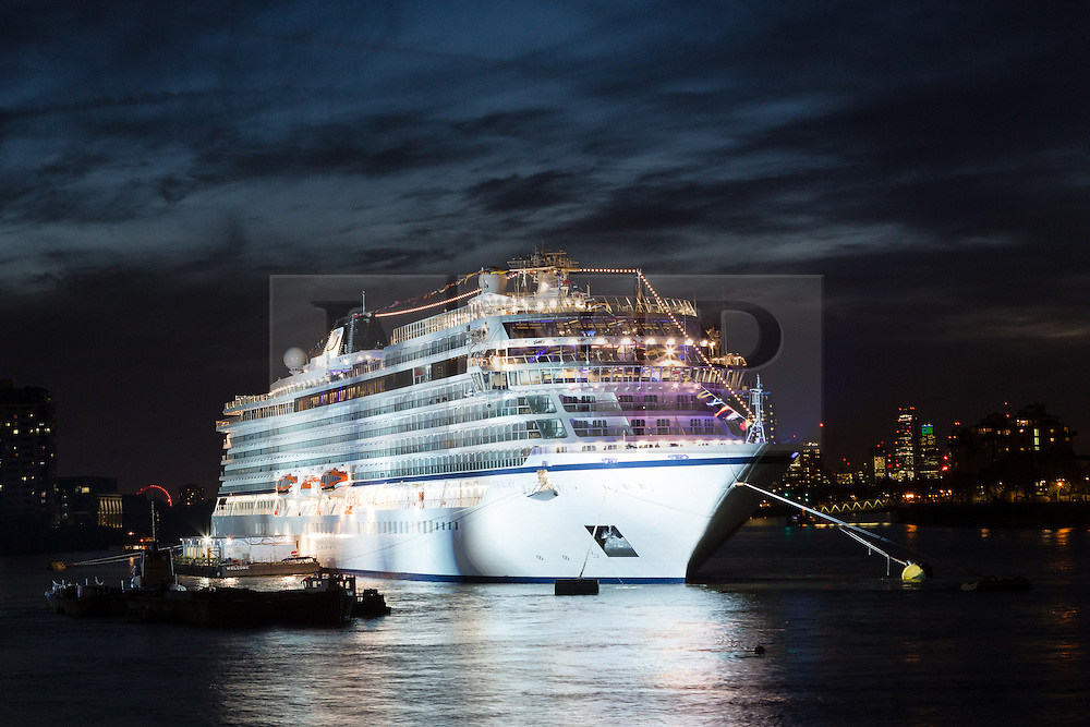 © Licensed to London News Pictures. 06/05/2016. LONDON, UK.  The Viking Sea cruise ship moored at Greenwich on the River Thames seen at night shortly before fireworks explode and light up the night sky behind the Viking Sea cruise ship. The fireworks celebrate the chistening of the 930 passenger capacity liner which took place earlier today. Photo credit: Vickie Flores/LNP