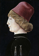 Nobleman of Ferrara' c1460. Tempera on wood. Cosimo Tura (c1430-1495) Italian early Renaissance painter. Profile Head and shoulders profile portrait of fair haired young man wearing a red hat.