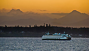 The Spokane, part of the Washington State Ferry system, plies Puget Sound towards Kingston on the Kitsap Peninsula, Washington, USA. The distant peak on the left is The Brothers (6866 feet elevation) in the Olympic Mountains on the Olympic Peninsula.