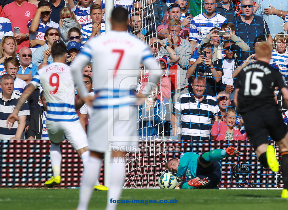 Charlie Austin of Queens Park Rangers sees his penalty saved by Allan McGregor of Hull City during the Barclays Premier League match at the Loftus Road Stadium, London<br /> Picture by John Rainford/Focus Images Ltd +44 7506 538356<br /> 16/08/2014
