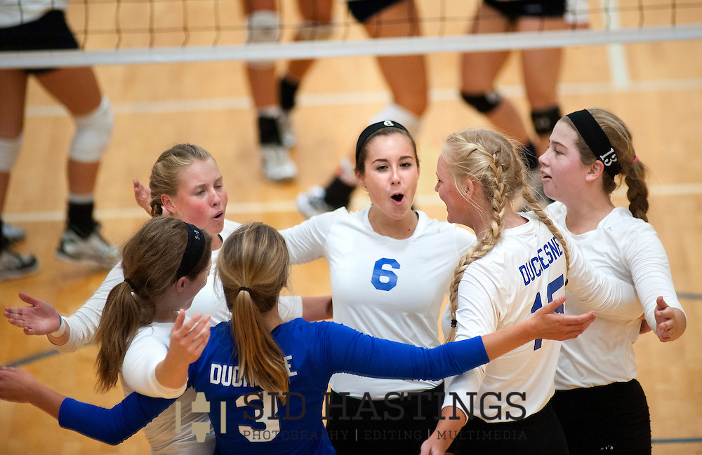 25 AUG. 2015 -- ST. CHARLES, Mo. -- Volleyball players from Duchesne High School, including Erica Maloney (2), McKenzie Struckhoff (1), Corinne Stulce (3), Molly Sifford (6), Natalie Schroeder (15) and Rachel Briscoe (13), celebrate after scoring a point against St. Pius X High School at Duchesne in St. Charles, Mo. Tuesday, Aug. 25, 2015. St. Pius won, 2-0 (25-14, 25-23), to advance to 6-0. It was Duchesne's first match, dropping them to 0-1 on the year. Photo © copyright Sid Hastings.