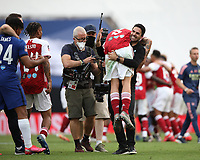 Football - 2020 Emirates 'Heads Up' FA Cup Final - Arsenal vs. Chelsea <br /> <br /> Mikel Arteta (Arsenal head coach) and Dani Ceballos (A) celebrate victory, at Wembley Stadium.<br /> <br /> The match is being played behind closed doors because of the current COVID-19 Coronavirus pandemic, and government social distancing/lockdown restrictions.