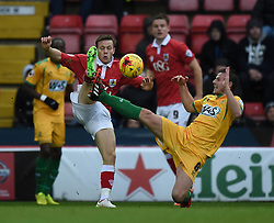 Yeovil Town's James Berrett challenges Bristol City's Todd Kane - Photo mandatory by-line: Paul Knight/JMP - Mobile: 07966 386802 - 26/12/2014 - SPORT - Football - Bristol - Ashton Gate - Bristol City v Yeovil Town - Sky Bet League One