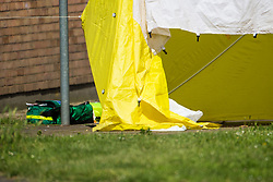 Abandoned paramedic equipment lies next to the tent marking the spot where a 24 year old male known locally as Mali died at the scene of yet another murder, this time on an estate on Crows Road in Barking, London, May 18 2018.