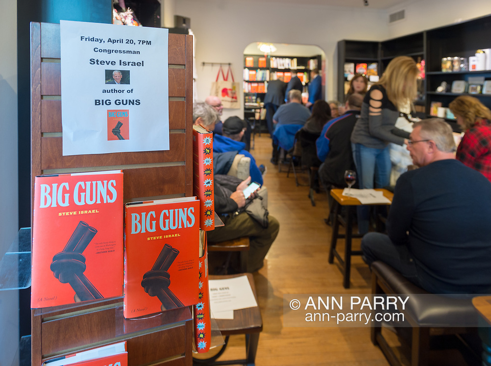 """Rockville Centre, New York, USA. April 20, 2018. Rep. STEVE ISRAEL speaks at special event for Nassau County debut of the former Congressman's (NY - Dem) newest novel """"Big Guns"""" - a satire of the strong gun lobby, weak Congress, and small Long Island town - at the Turn of the Corkscrew Books & Wine store. Moderator RITA KESTENBAUM is a gun-control activist and former councilwoman whose daughter was shot to death at college."""