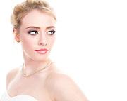 High key bridal closeup of model Savannah O'Hara against bright white background.