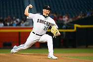 Apr 5, 2016; Phoenix, AZ, USA; Arizona Diamondbacks starting pitcher Shelby Miller (26) delivers a pitch in the first inning against the Colorado Rockies at Chase Field. Mandatory Credit: Jennifer Stewart-USA TODAY Sports