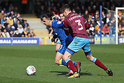 AFC Wimbledon attacker Egli Kaja (21) battles for possession with Scunthorpe United defender Conor Townsend (3) during the EFL Sky Bet League 1 match between AFC Wimbledon and Scunthorpe United at the Cherry Red Records Stadium, Kingston, England on 7 April 2018. Picture by Matthew Redman.