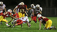Marion's Mitch Ross (57) runs towards the ball after Western Dubuque's Riley Pfieler (5) fumbled during their first round playoff game at Thomas Park Field in Marion on Wednesday, October 24, 2012. Ross recovered the fumble to give Marion possession.