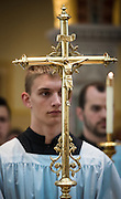 An altar server carries a processional cross during a Mass at St. Francis Xavier Cathedral in Green Bay. (Sam Lucero photo)