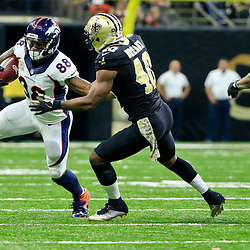 Nov 13, 2016; New Orleans, LA, USA;  Denver Broncos wide receiver Demaryius Thomas (88) is tackled by New Orleans Saints cornerback Ken Crawley (46) during the first half of a game at the Mercedes-Benz Superdome. Mandatory Credit: Derick E. Hingle-USA TODAY Sports