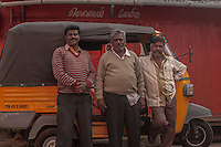 Tuk tuk drivers pose in Ooty, India.