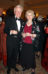 DAME ELIZABETH BUTLER-SLOSS and her husband JOSEPH BUTLER-SLOSS at a dinner in aid of the BAAF (British Association for Adoption & Fostering) held at The Savoy, London on 22nd March 2005.<br />