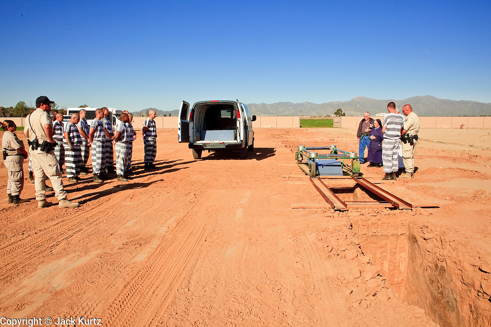"18 MARCH 2010 - SURPRISE, AZ:  Indigent people who die in Maricopa County are buried in White Tanks Cemetery on Camelback Rd. in an unincorporated part of the county near Surprise. The county spent about $2.5 million to inter indigent people in what is Maricopa County's ""potters field."" About 3,000 people, children and adults, are buried in the dusty field west of Phoenix.        PHOTO BY JACK KURTZ"