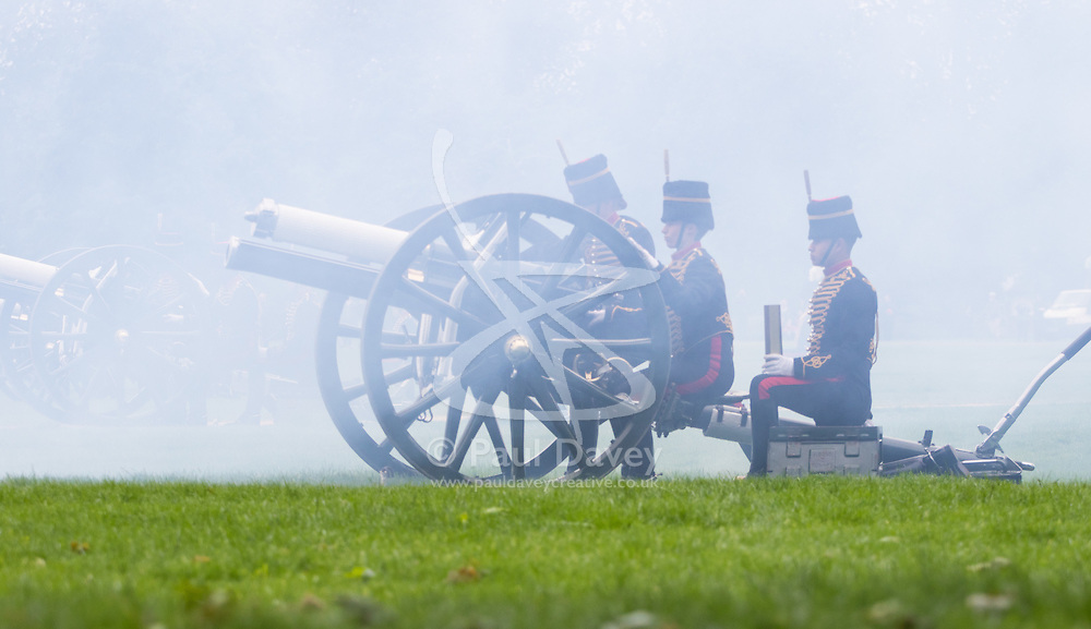 Hyde Park, London, June 2nd 2016. Soldiers and guns of the King's Troop Royal Horse Artillery fire a 41 round Royal Salute to mark the 63rd anniversary of the coronation of Britain's Monarch HM Queen Elizabeth II. PICTURED: A gun spews fame as it fires. PICTURED: Soldiers and their gun are silhouetted against the smoke.