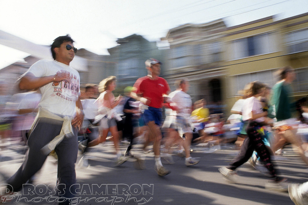 Runners descend the Hayes Street hill during the 80th Bay to Breakers footrace, Sunday, May 19, 1991 in San Francisco. (Photo by D. Ross Cameron)