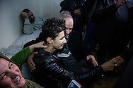 5/1/2016--Iraq,Kirkuk-- Hussain in the arms of his parent surrounded by his family and relatives.