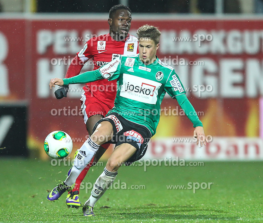 23.11.2013, Keine Sorgen Arena, Ried im Innkreis, AUT, 1. FBL, SV Josko Ried vs FC Admira Wacker Moedling, 16. Runde, im Bild Patrick Moeschl, (SV Josko Ried, #25) und Wilfried Domoraud, (FC Admira Wacker Moedling, #11) // during Austrian Football Bundesliga Match, 16th round, between SV Josko Ried and FC Admira Wacker Moedling at the Keine Sorgen Arena, Ried im Innkreis, Austria on 2013/11/23. EXPA Pictures © 2013, PhotoCredit: EXPA/ Roland Hackl