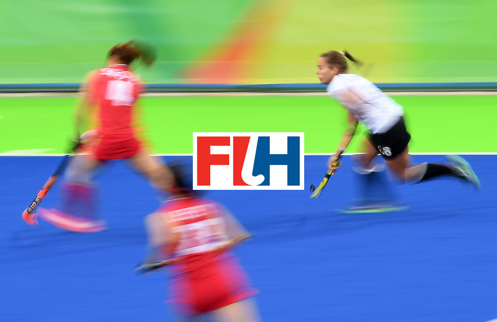 Germany's Lisa Altenburg (R) chases the ball during the women's field hockey Germany vs South Korea match of the Rio 2016 Olympics Games at the Olympic Hockey Centre in Rio de Janeiro on August, 10 2016. / AFP / MANAN VATSYAYANA        (Photo credit should read MANAN VATSYAYANA/AFP/Getty Images)