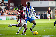 Hearts FC Midfielder Morgaro Gomis makes a vital tackle on Kilmarnock FC Midfielder Tope Obadeyi during the Ladbrokes Scottish Premiership match between Heart of Midlothian and Kilmarnock at Tynecastle Stadium, Gorgie, Scotland on 3 October 2015. Photo by Craig McAllister.