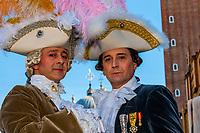 Revelers in carnival costume,  Piazza San Marco, Venice Carnival (Carnevale di Venezia), Venice, Italy.