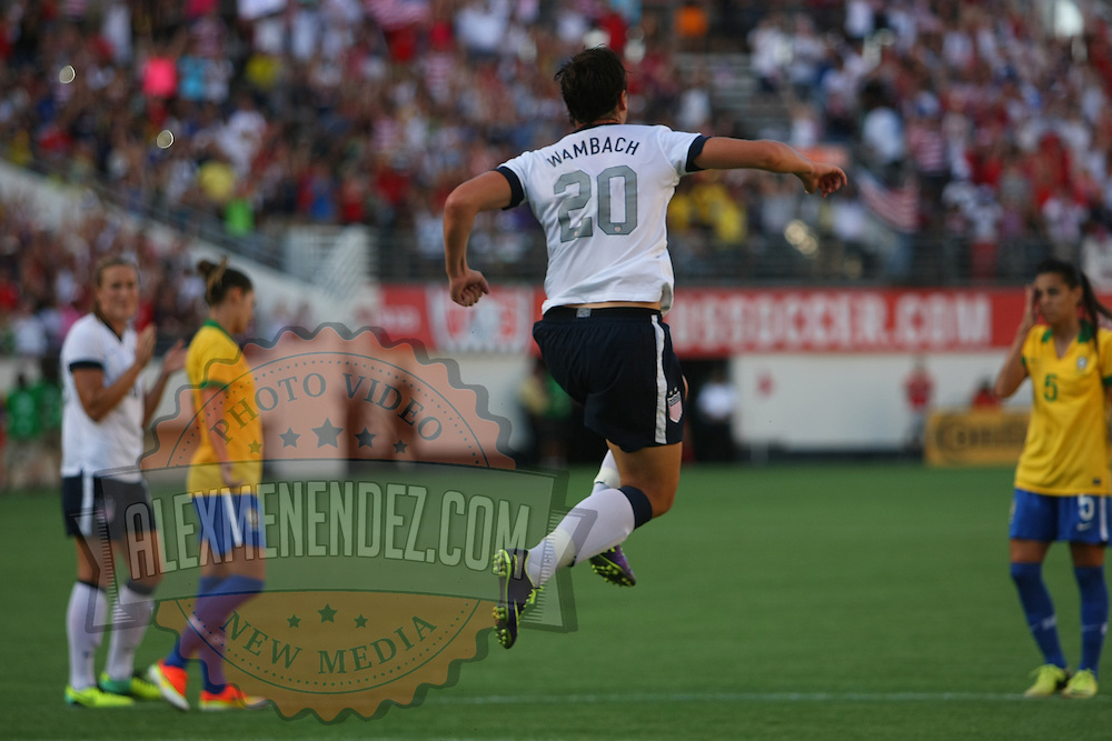U.S. forward Abby Wambach (20) scores a goal on a penalty kick, during a women's soccer International friendly match between Brazil and the United States National Team, at the Florida Citrus Bowl  on Sunday, November 10, 2013 in Orlando, Florida. (AP Photo/Alex Menendez)