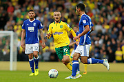Norwich City midfielder Tom Trybull (19) Birmingham City defender Maxime Colin (5) during the EFL Sky Bet Championship match between Norwich City and Birmingham City at Carrow Road, Norwich, England on 9 September 2017. Photo by Phil Chaplin.
