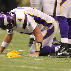 Jan 24, 2010; New Orleans, LA, USA; Minnesota Vikings quarterback Brett Favre (4) is injured on a play that resulted in a roughing the quarterback penalty during a 31-28 overtime victory by the New Orleans Saints over the Minnesota Vikings in the 2010 NFC Championship game at the Louisiana Superdome. Mandatory Credit: Derick E. Hingle-US PRESSWIRE