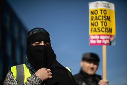"© Licensed to London News Pictures . 23/02/2019. Salford, UK. ANTI FASCIST COUNTER PROTESTERS . Supporters of Tommy Robinson (real name Stephen Yaxley-Lennon ) and anti-fascists opposed to the former EDL leader and his followers , gather near to the BBC at Media City to protest , as Yaxley-Lennon hosts a rally showing a home-made documentary , "" Panodrama "" , described as an exposé of the BBC's Panorama documentary series . A BBC Panorama documentary is due to feature an investigation in to Yaxley-Lennon in the near future . Photo credit: Joel Goodman/LNP"