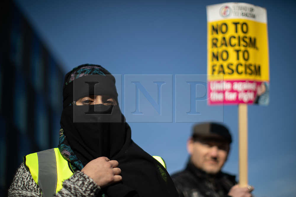 """© Licensed to London News Pictures . 23/02/2019. Salford, UK. ANTI FASCIST COUNTER PROTESTERS . Supporters of Tommy Robinson (real name Stephen Yaxley-Lennon ) and anti-fascists opposed to the former EDL leader and his followers , gather near to the BBC at Media City to protest , as Yaxley-Lennon hosts a rally showing a home-made documentary , """" Panodrama """" , described as an exposé of the BBC's Panorama documentary series . A BBC Panorama documentary is due to feature an investigation in to Yaxley-Lennon in the near future . Photo credit: Joel Goodman/LNP"""