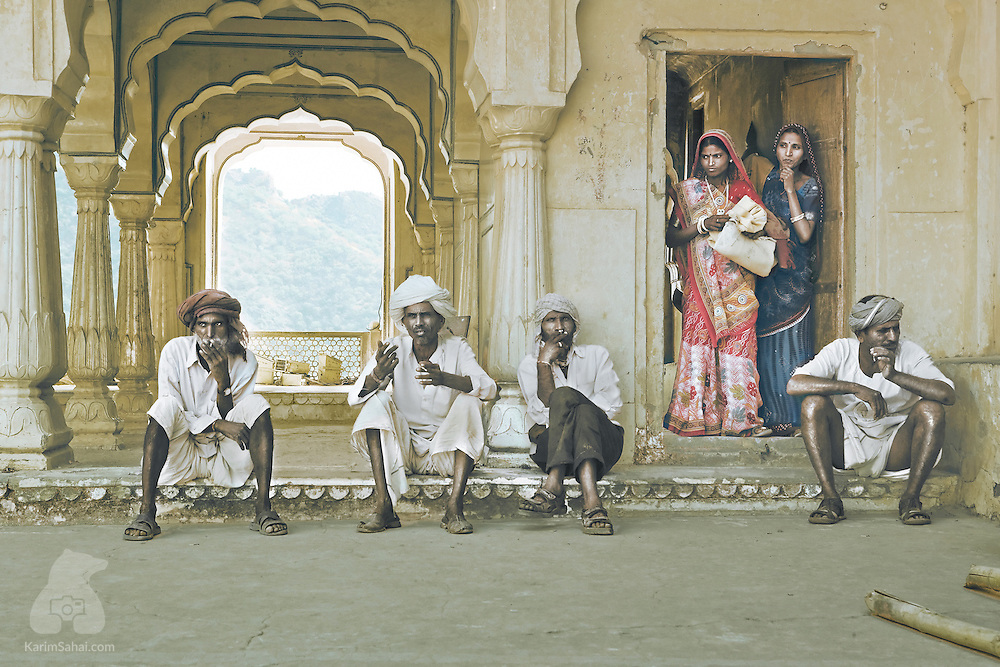 A group of maintenance workers take a break in the shadow of the Diwan-e-Khas, a marble chamber inside the imposing Amer Fort complex in Jaipur, Rajasthan, India.