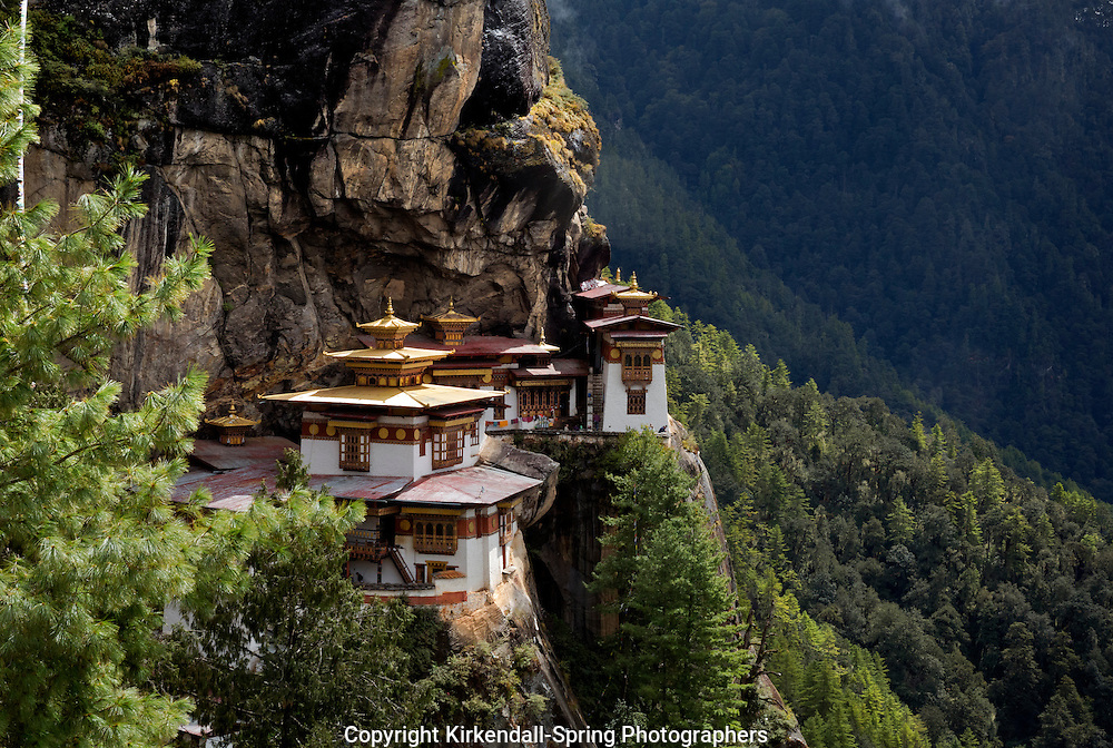 BU00334-00...BHUTAN - Taktshang Goemba, (the Tiger's Nest Monastery), perched on the side of a cliff high above the Paro River Valley.