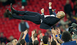 28.05.2011, Wembley Stadium, London, ENG, UEFA CHAMPIONSLEAGUE FINALE 2011, FC Barcelona (ESP) vs Manchester United (ENG), im Bild FC Barcelona's head coach Josep Guardiola is thrown into the air by his squad as he celebrates winning the European Cup after thrashing Manchester United 3-1 during the UEFA Champions League Final at Wembley Stadium, EXPA Pictures © 2011, PhotoCredit: EXPA/ Propaganda/ Chris Brunskill *** ATTENTION *** UK OUT!