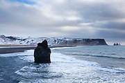 Reynisdrangar basalt sea stacks (troll rocks) and black volcanic sand beach Reynisfjara near Vík i Myrdal, Iceland