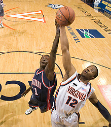 Richmond forward Oumar Sylla (11) and Virginia forward Jamil Tucker (12) leap for a rebound.  The Virginia Cavaliers men's basketball team defeated the Richmond Spiders 66-64 in the first round of the College Basketball Invitational (CBI) tournament held at the University of Virginia's John Paul Jones Arena in Charlottesville, VA on March 18, 2008.