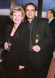MRS DEBBIE HODGES and actor PETER POLYCARPOU, at a dinner in London on 27th April 1998.MHD 15