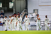 Kent come out of the pavilion during the Specsavers County Champ Div 1 match between Surrey County Cricket Club and Kent County Cricket Club at the Kia Oval, Kennington, United Kingdom on 10 July 2019.