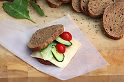 Yellow cheese sandwich with tomato and cucumber