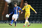 Joe Bunney challenged by Callum Butcher during the EFL Sky Bet League 1 match between Rochdale and Millwall at Spotland, Rochdale, England on 21 March 2017. Photo by Daniel Youngs.