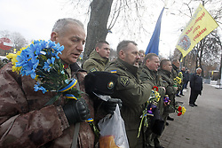 November 21, 2018 - Kiev, Ukraine - Ukrainian servicemen sing the national anthem at the memorial for the killed EuroMaidan activists during marking the 5th anniversary of the Euromaidan Revolution in Kiev, Ukraine, on 21 November 2018. Euromaidan Revolution or Revolution of Dignity was a wave of demonstrations and civil unrest in Ukraine, which began on the night of 21 November 2013 with public protests at Independence Square in Kiev, demanding European integration.The protests led to the 2013-2014 Ukrainian revolution and the ouster of President Viktor Yanukovych. (Credit Image: © Serg Glovny/ZUMA Wire)